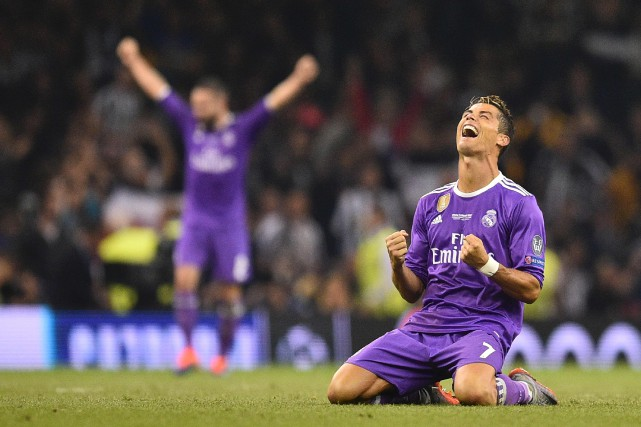 La réaction de Cristiano Ronaldo à la fin... (Photo Glyn KIRK, AFP)