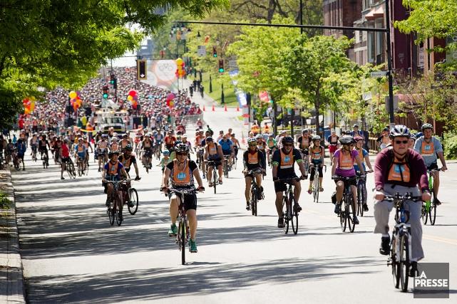 Pour les 50ans de Vélo Québec, le Tour de l'Île de Montréal a tenu dimanche... (PHOTO NINON PEDNAULT, LA PRESSE)