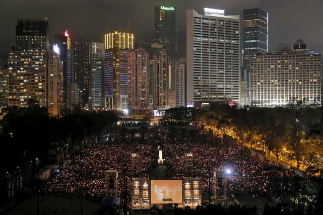 Le territoire semi-autonome de Hong Kong est le... (AP, Vincent Yu)