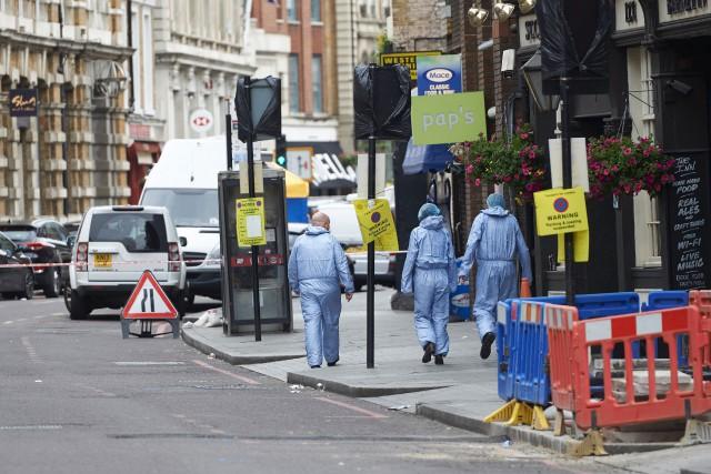 Les enquêtes policières se poursuivent deux jours après... (PHOTO ARCHIVES AFP)