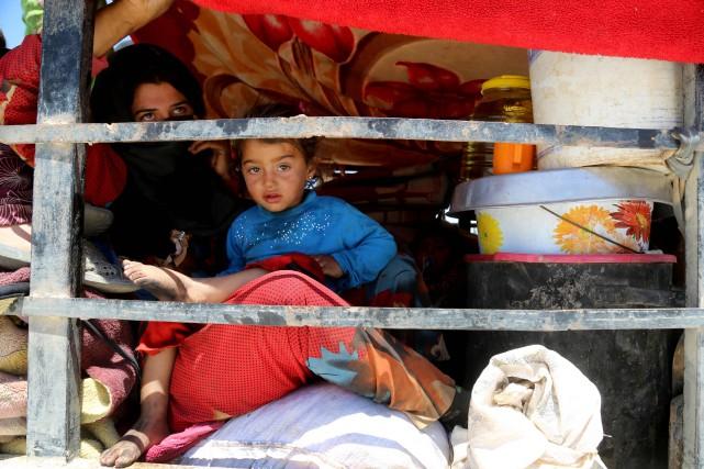 Près de Raqqa, des Syriens rêvent de fêter la fin du ramadan dans leur ville,... (PHOTO AFP)