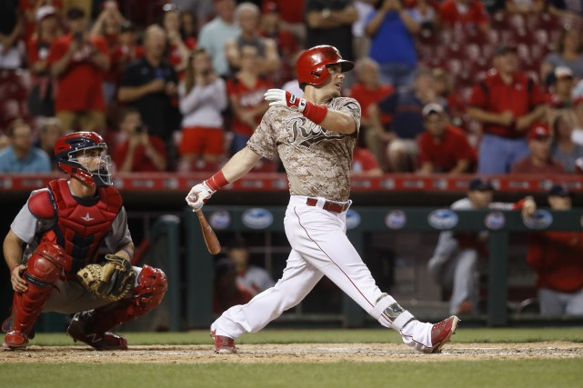 Scooter Gennett a claqué son quatrième circuit de... (Photo John Minchillo, AP)