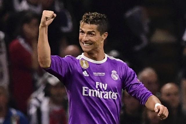 Après le titre de la Ligue de champions... (AFP, Javier Soriano)