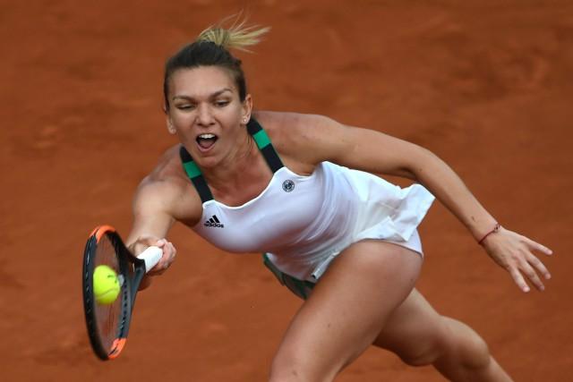 Simona Halepdeviendra numéro 1 mondiale si elle remporte... (PHOTO AFP)