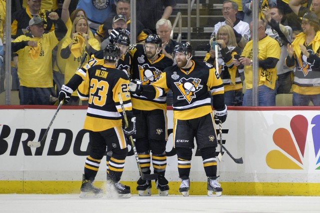 Les Penguins de Pittsburgh ont retrouvé le confort de leur domicile et le vent... (PHOTO REUTERS)