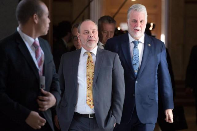 Philippe Couillard et son chef de cabinetJean-Louis Dufresne.... (Archives, La Presse canadienne)
