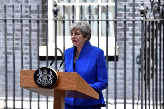 TheresaMay s'est exprimée à l'issue d'une brève rencontre... (PHOTO BEN STANSALL, AGENCE FRANCE PRESSE)