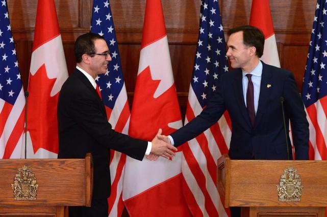 Le secrétaire américain au Trésor, Steven Mnuchin, et... (PHOTO LA PRESSE CANADIENNE)