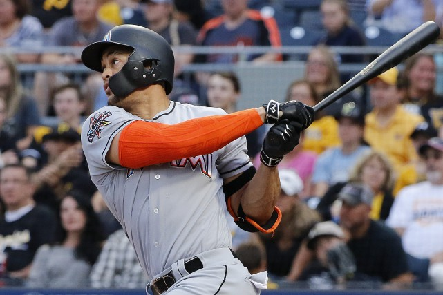 La distance du circuit de Giancarlo Stanton: 449... (Photo Gene J. Puskar, AP)
