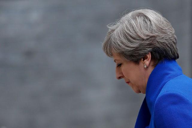 Vendredi, Theresa May est retournée affaiblie au 10,... (AFP, Adrian Dennis)