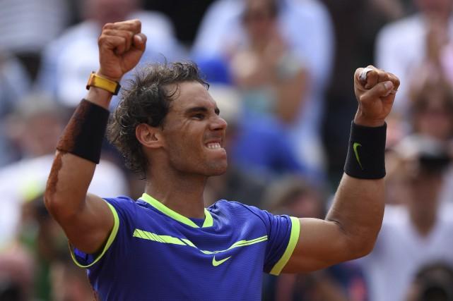 Avec ce dixième sacre à Roland-Garros, Rafael Nadal... (AFP, François Xavier Marit)