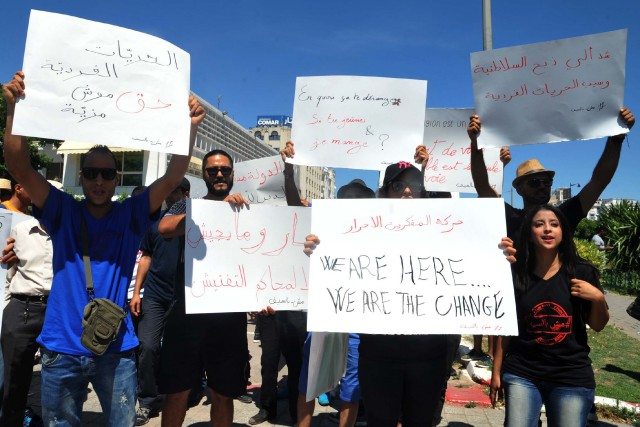 À l'appel du mouvement «Mouch Bessif» («pas contre... (photo Sofienne HAMDAOUI, AFP)