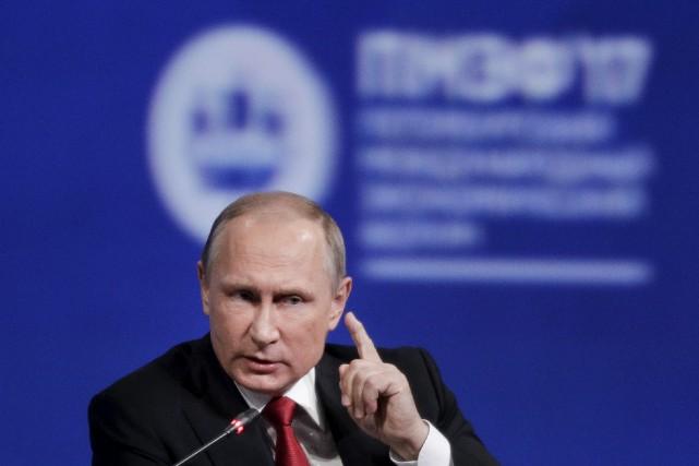 Le président russe, Vladimir Poutine... (AP, Dmitry Lovetsky)
