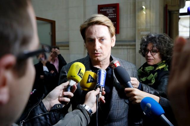 Le 11 mars 2016, Benoît Magimelconduisait une voiture... (AFP, François Guillot)
