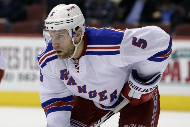 Le défenseur Dan Girardi a disputé 788 matchs en... (Photo Rick Scuteri, archives AP)
