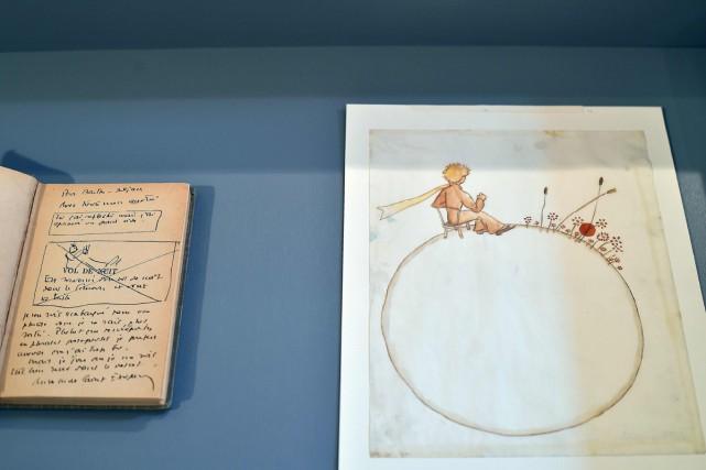Deux aquarelles du Petit Prince, le célèbre garçon aux cheveux d'or d'Antoine... (PHOTO AFP)
