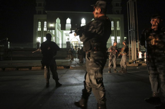 Security forces respond at the site of a... (Photo Massoud Hossaini, AP)