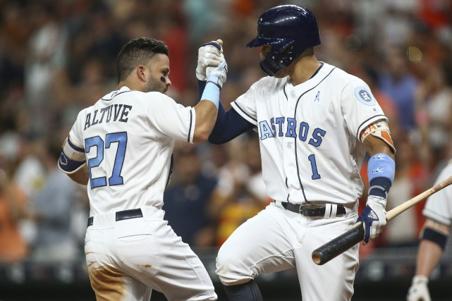 Jose Altuve (27) et Carlos Correa (1).... (Photo Troy Taormina, USA TODAY Sports)