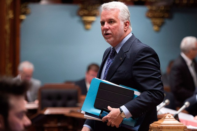 Accompagné du délégué général du Québec à New... (PHOTO JACQUES BOISSINOT, LA PRESSE CANADIENNE)