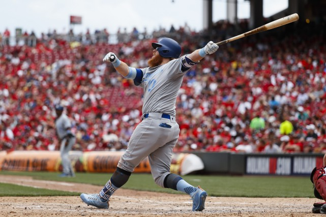 Justin Turner a frappé un circuit de 3... (Photo John Minchillo, AP)