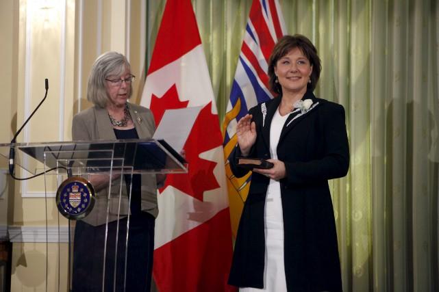 Le gouvernement minoritaire de Christy Clark (à droite,... (La Presse canadienne, Chad Hipolito)