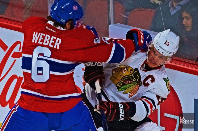 Shea Weber et Jonathan Toews... (Photo André Pichette, archives La Presse)