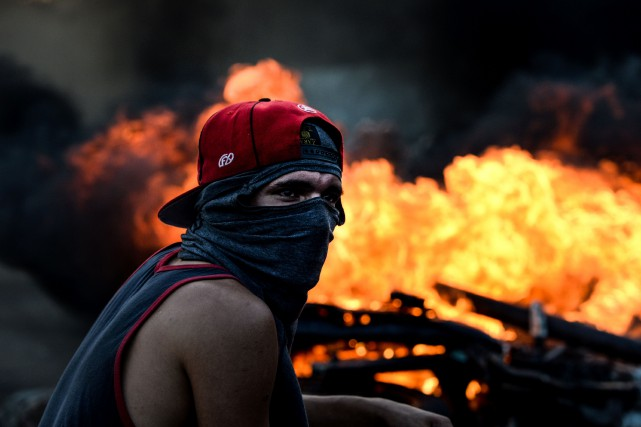 Les manifestations de jeudi à travers le Venezuela... (PHOTO FEDERICO PARRA, AFP)