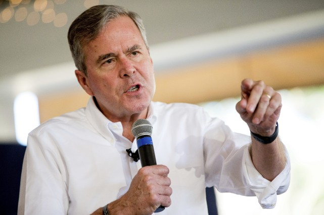 Jeb Bush a rejoint le groupe de l'homme... (Photo Andrew Harnik, AP)