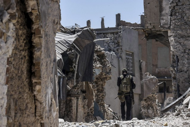 Les ruelles du vieux Mossoul sont tapissées d'énormes... (AFP, MOHAMED EL-SHAHED)