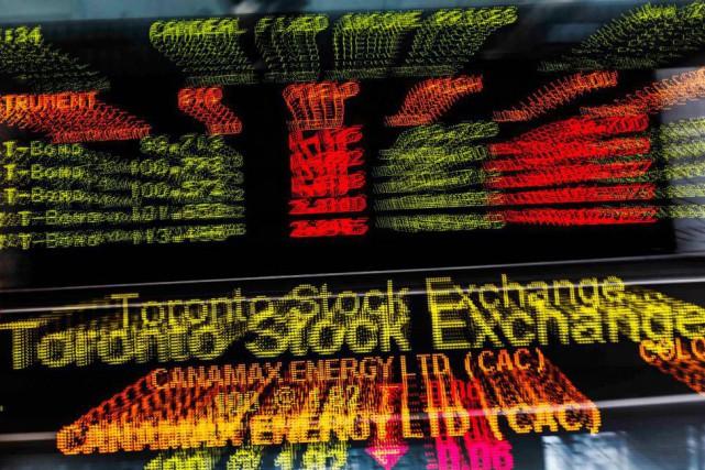 L'indice composé S&P/TSX du parquet torontois lâchait 77,90... (photo mark blinch, archives reuters)