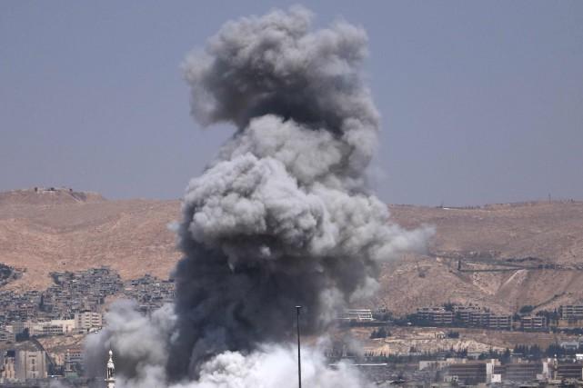 Un raid aérien de la coalition dirigée par les États-Unis a tué 57personnes... (Photo Mohammed EYAD, archives Agence France-Presse)