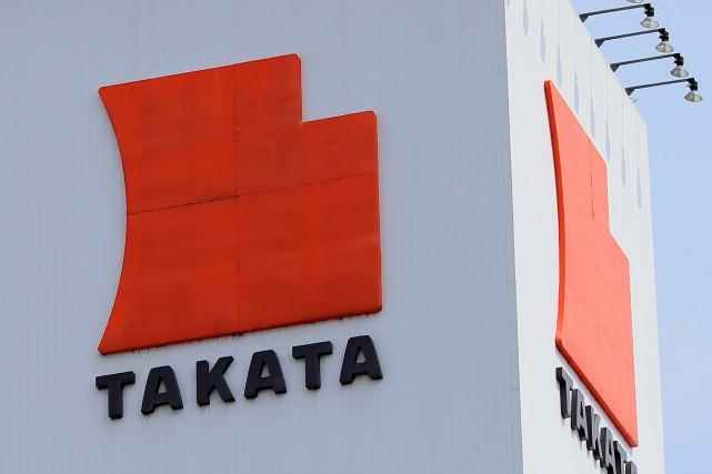 L'équipementier japonais Takata, dont les coussins gonglables défectueux... (Photo archives AFP)
