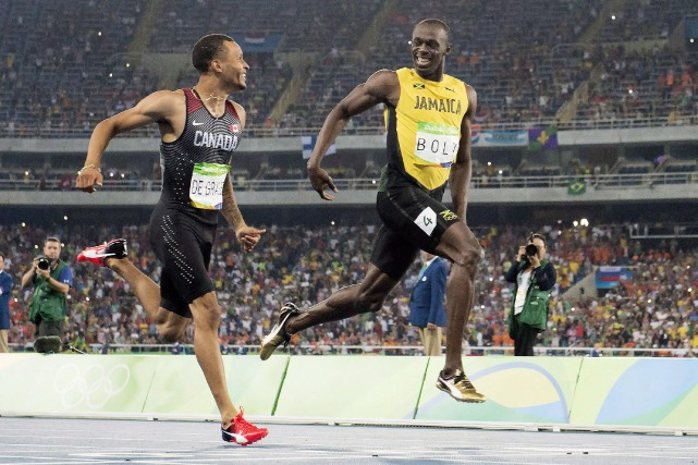 Andre De Grasse et Usain Bolt lors des... (Photo Frank Gunn, archives La Presse canadienne)