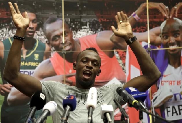 Le sprinteur jamaïcain et champion du monde au... (AP, Petr David Josek)
