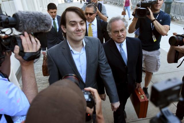 Martin Shkreli, dont le sourire narquois est devenu... (AFP, Timothy A. Clary)