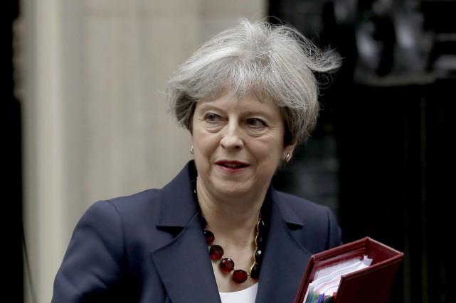 Les conservateurs de Theresa May sont minoritaires au... (AP, Matt Dunham)