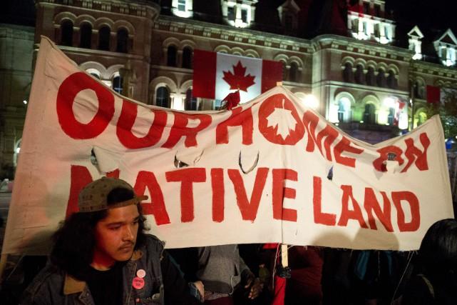 La police aurait arrêté une dizaine de personnes... (Photo Justin Tang, La Presse canadienne)