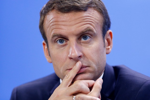 Les relations entre Donald Trump et Emmanuel Macron... (Photo Hannibal Hanschke, Reuters)