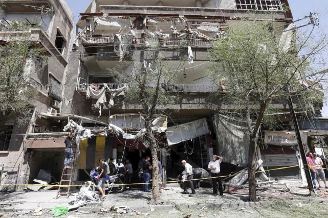 L'explosion d'un véhicule a soufflé cet édifice situé... (AFP, Louai Beshara)