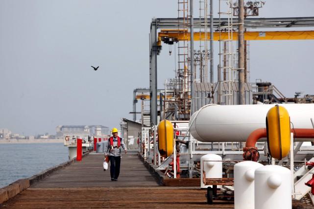 Le groupe pétrolier français Total conclura lundi un... (Archives AFP, Atta Kenare)