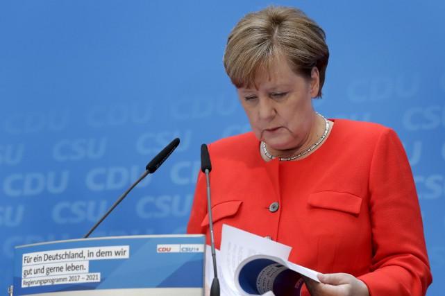 Les dissensions entre Angela Merkelet le président américain... (AP, Michael Sohn)