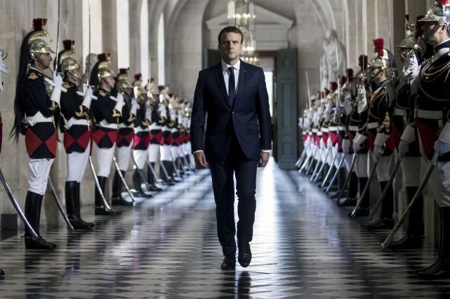 Le président français, Emmanuel Macron, a promis des... (AP, Étienne Laurent)