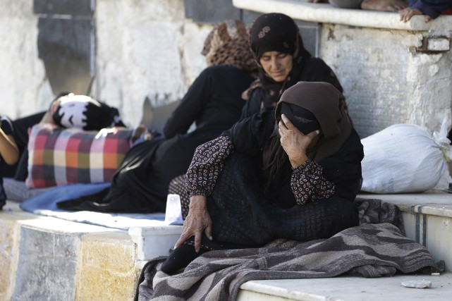 Des milliers de rebelles et de civils avaient... (AFP)