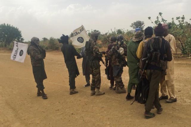 Des membres dugroupe djihadiste nigérian Boko Haram.... (REUTERS)