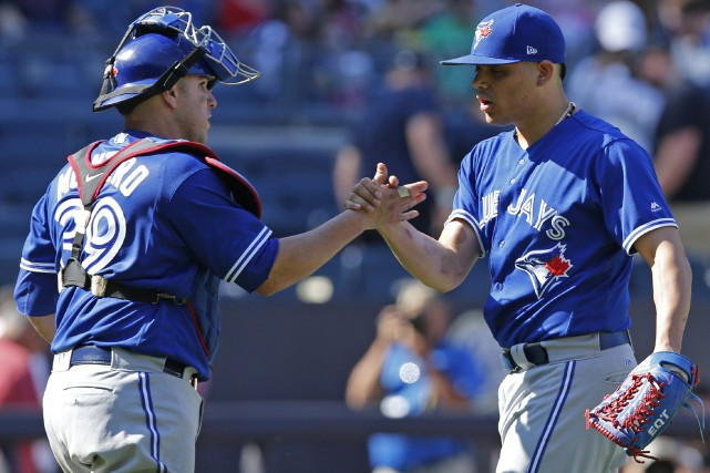 Miguel Montero et Roberto Osuna... (Photo Kathy Willens, Associated Press)