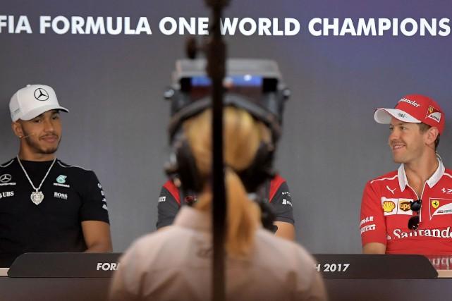 Lewis Hamilton et Sebastian Vettel étaient réunis en... (Photo Joe Klamar, AFP)
