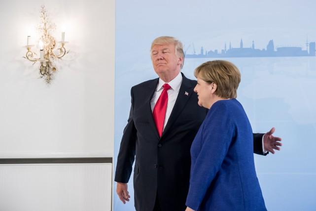 Angela Merkel et Donald Trump quittant unerencontre bilatérale... (PHOTO AFP)