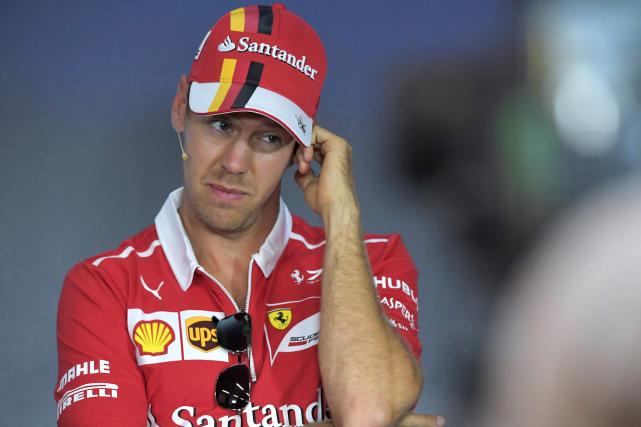 Sebastian Vettel... (AFP, JOE KLAMAR)