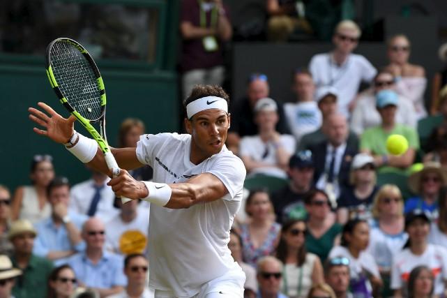L'Espagnol Rafael Nadal a vaincul'espoir russe Karen Khachanov... (AFP, Glyn KIRK)