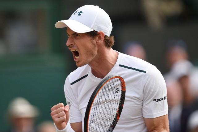 Andy Murray a eu besoin de quatre manches... (Photo Toby Melville, Reuters)